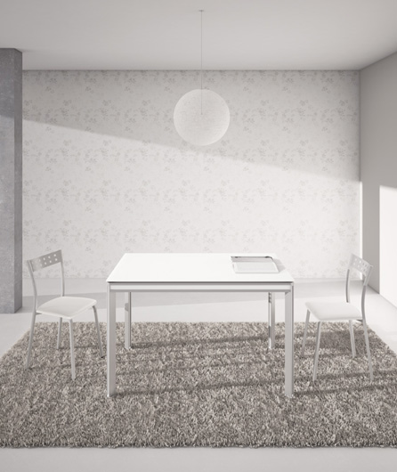 Metasola presents the extensible table itaca for Table extensible 12 couverts