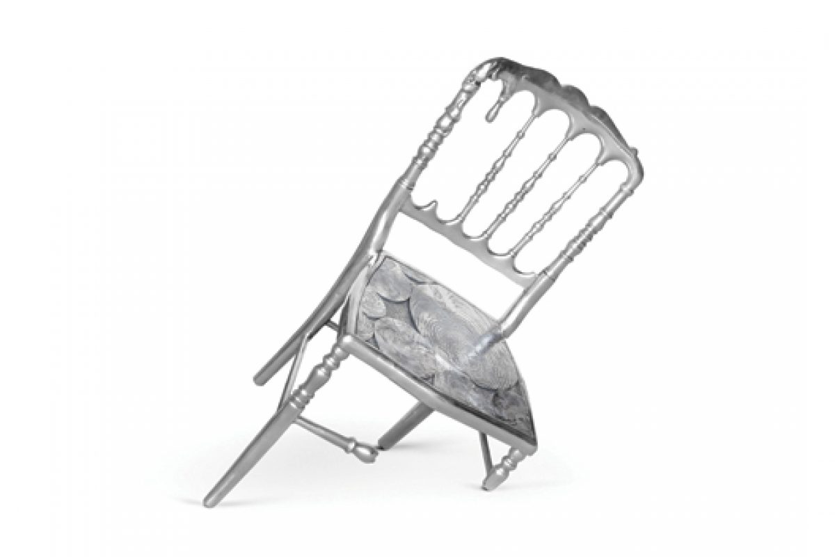 Emporium, the aluminum chair with only three legs, designed by Marco Costa for Boca do Lobo
