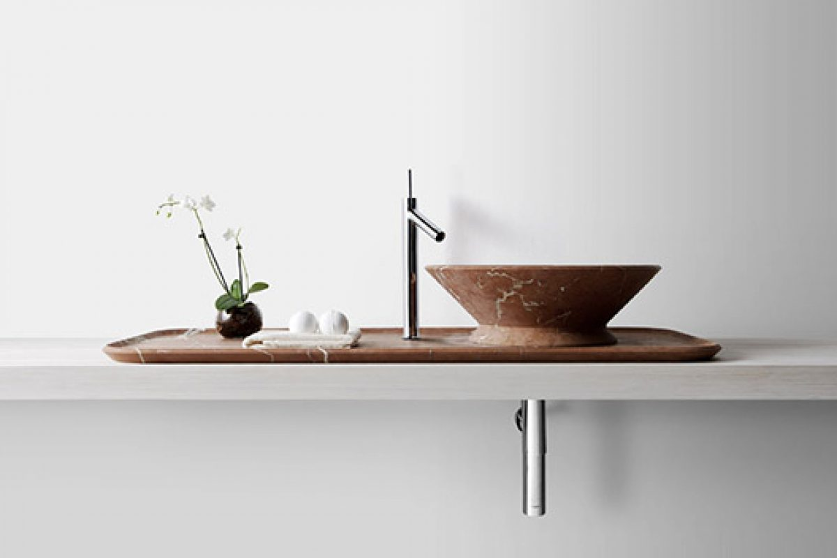 Kreoo puts on tray the Nabhi sink, designed by Enzo Berti in marble Red Alicante