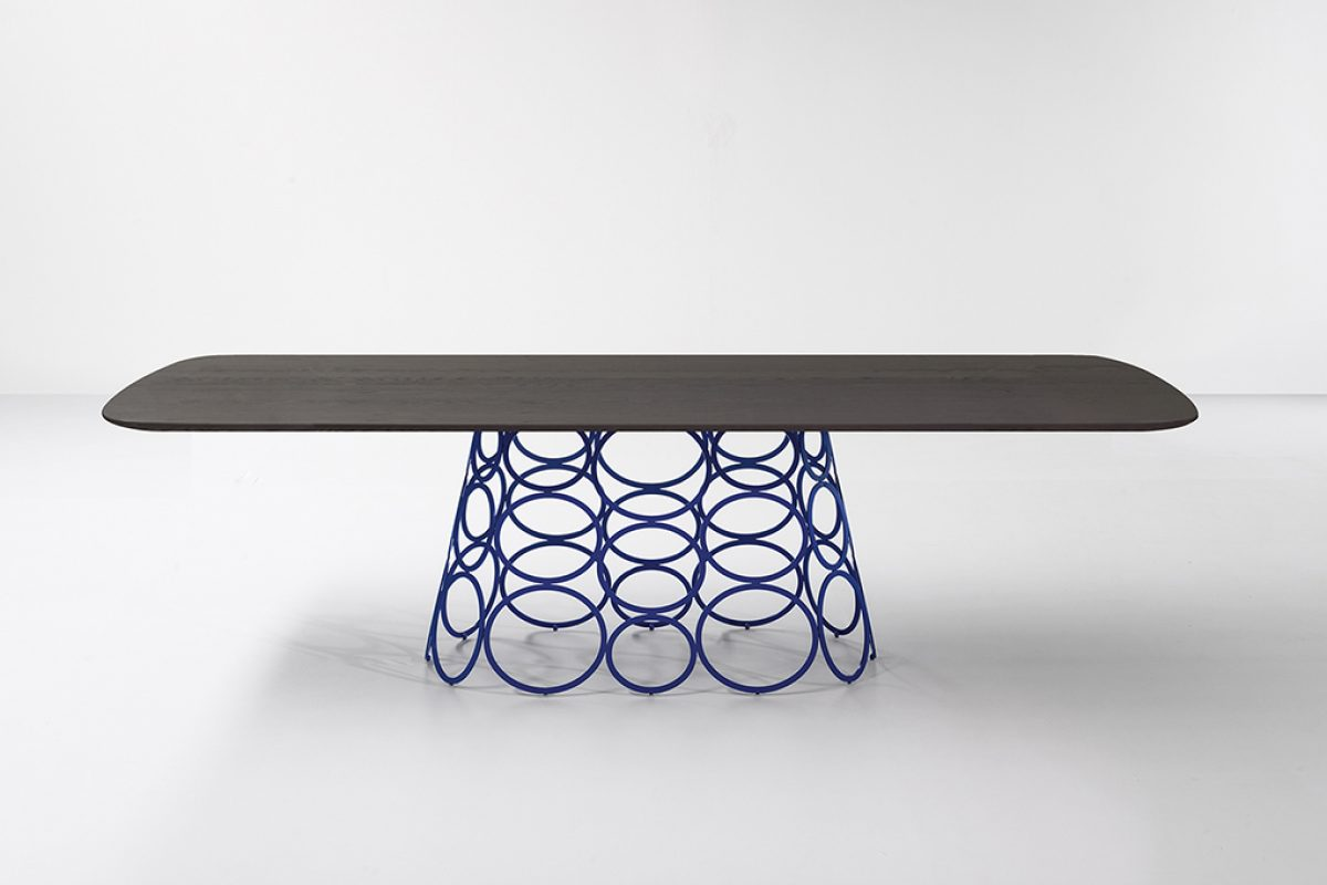Surprise hoops become protagonists in Hulahoop, the table designed by Alessandro Busana for Bonaldo