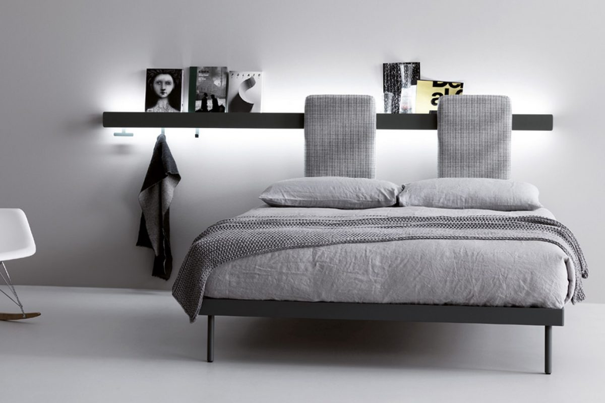 Innovative bed system designed by Monica Graffeo for Caccaro where the wall becomes a multi-purpose headboard