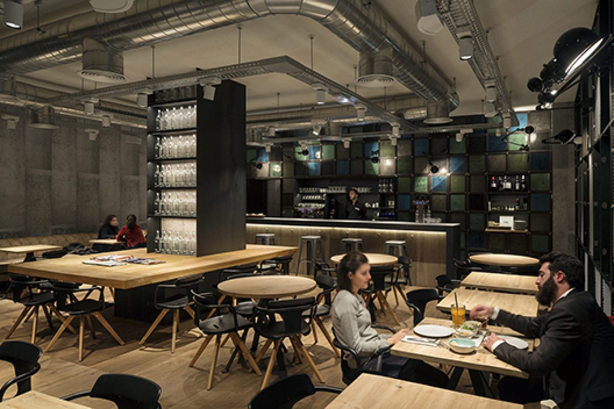 Industrial style and reclaimed materials at the OhBo organic café in Barcelona designed by Isabel Lopez Vilalta