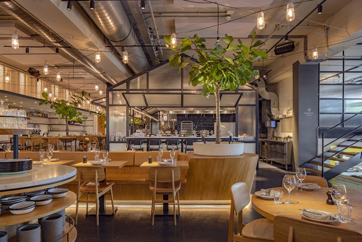 Concrete studio brings the Mediterranean outdoor patio atmosphere to the inside of Neni restaurant in a former Citroën garage of Amsterdam