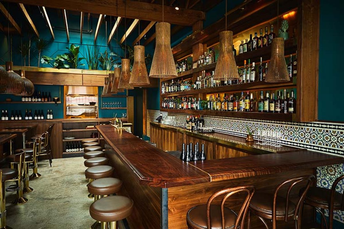 Heliotrope Architects designed Rupee Bar, the restaurant in Seattle inspired by India and Sri Lanka