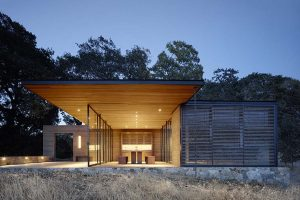 Quintessa pavilions among vineyards. A project by Walker Warner Architects in the Napa Valley